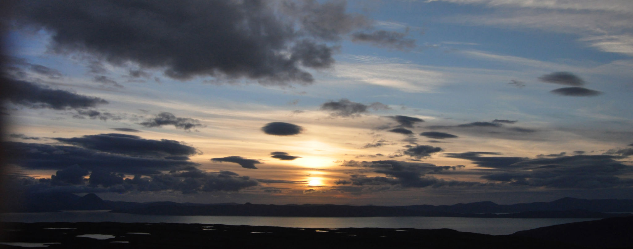 Sunset from the Bealach Na Ba looking over Raasay and the Isle of Skye